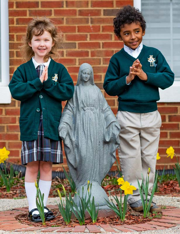 Two Children with Statue of the Madonna